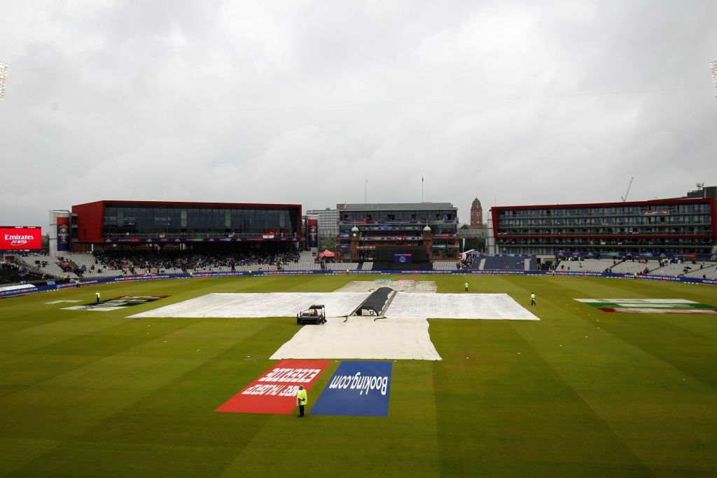 Manchester: A view of the pitch at Old Trafford covered with plastic sheets during rains that interrupted the 1st Semi-final match of 2019 World Cup between India and New Zealand in Manchester, England on July 9, 2019. (Photo: Surjeet Kumar/IANS) - Surjeet Kumar