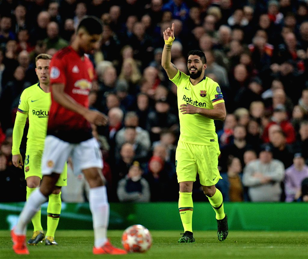 MANCHESTER, April 11, 2019 - Barcelona's Luis Suarez (R) celebrates an own-goal by Manchester United's Luke Shaw during the UEFA Champions League Quarter-Final first leg match between Manchester ...