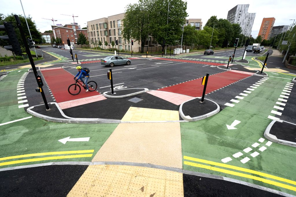 MANCHESTER (BRITAIN), July 9, 2020 A cyclist rides a bicycle on the cycle lane of a CYCLOPS (Cycle Optimised Protected Signals) junction in southern Manchester, Britain, on July 9, 2020. ...