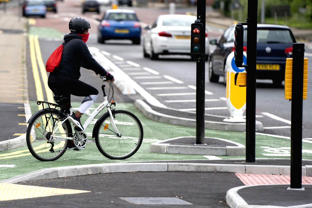MANCHESTER (BRITAIN), July 9, 2020 A woman rides a bicycle on the cycle lane of a CYCLOPS (Cycle Optimised Protected Signals) junction in southern Manchester, Britain, on July 9, 2020. ...