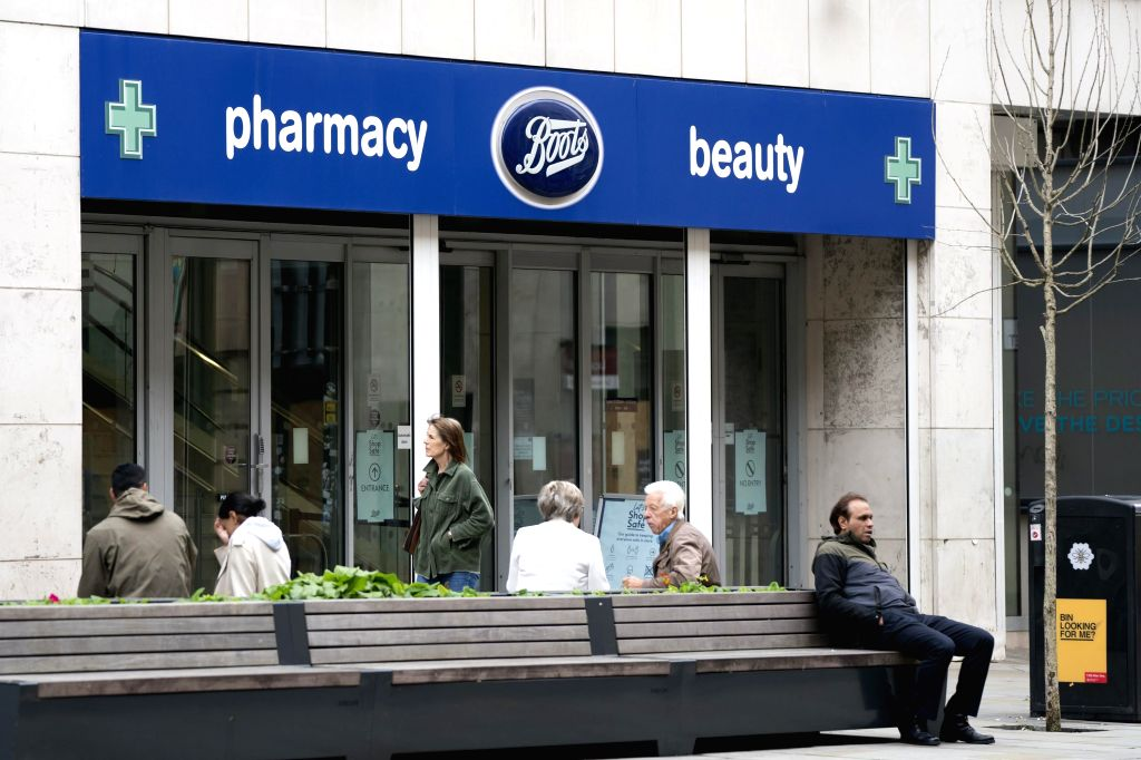 MANCHESTER (BRITAIN), July 9, 2020 People are seen outside a Boots store in Manchester, Britain, on July 9, 2020. British high street pharmacy chain Boots announced Thursday that it will ...