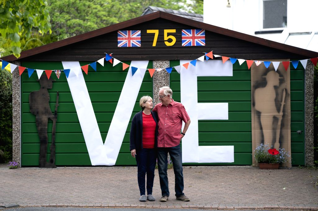 MANCHESTER (BRITAIN), May 8, 2020 Barbara and Brian Muir stand by their decorated garage to commemorate the 75th anniversary of of the end of World War II in Europe in Manchester, ...