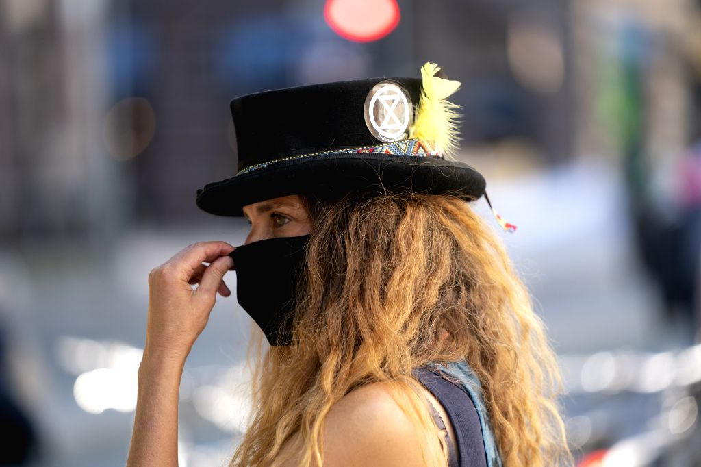Manchester (BRITAIN), Sept. 1, 2020 A protester takes part in an Extinction Rebellion demonstration in central Manchester, Britain, on Sept. 1, 2020. According to the plan of ...