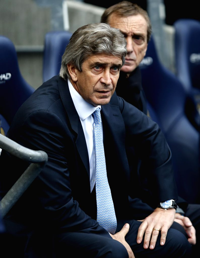 : MANCHESTER, Dec. 15, 2013 (Xinhua/IANS)Manchester City's manager Manuel Pellegrini looks on during the Barclays Premier League match between Manchester City and Arsenal at Etihad Stadium ...