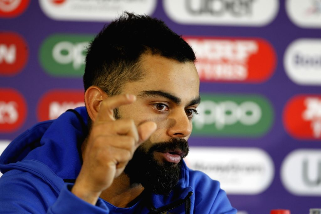 Manchester: India's captain Virat Kohli addresses a press conference ahead of the 46th match of World Cup 2019 against New Zealand at Old Trafford in Manchester, England on July 8, 2019. (Photo: Surjeet Kumar/ IANS) - Virat Kohli and Surjeet Kumar