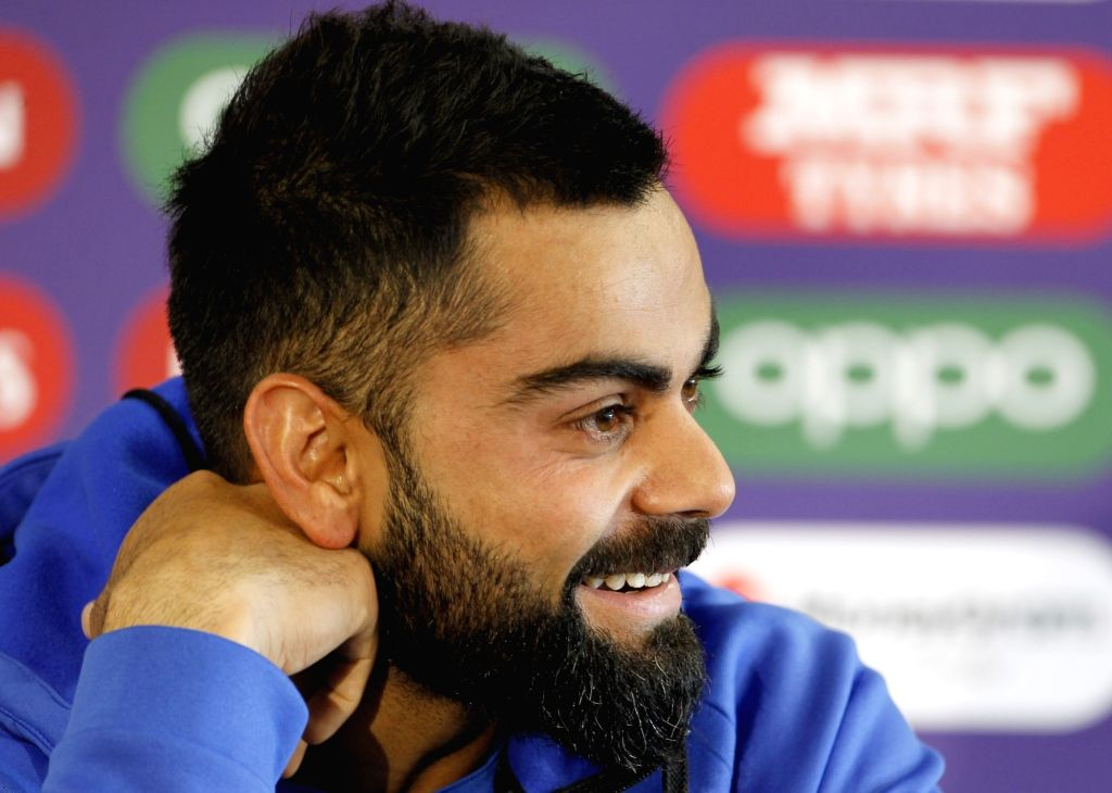 Manchester: India's captain Virat Kohli during a press conference ahead of the 46th match of World Cup 2019 against New Zealand at Old Trafford in Manchester, England on July 8, 2019. (Photo: Surjeet Kumar/ IANS) - Virat Kohli and Surjeet Kumar