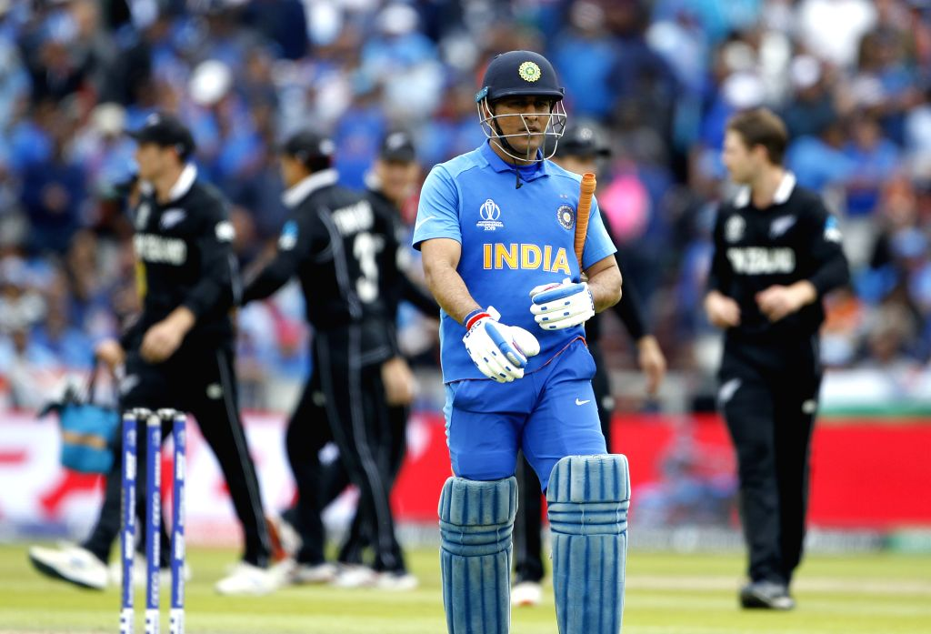 Manchester: India's M.S. Dhoni walks back to the pavilion after getting dismissed during the 1st Semi-final match of 2019 World Cup between India and New Zealand at Old Trafford in Manchester, England on July 10, 2019. (Photo: Surjeet Kumar/IANS) - Surjeet Kumar
