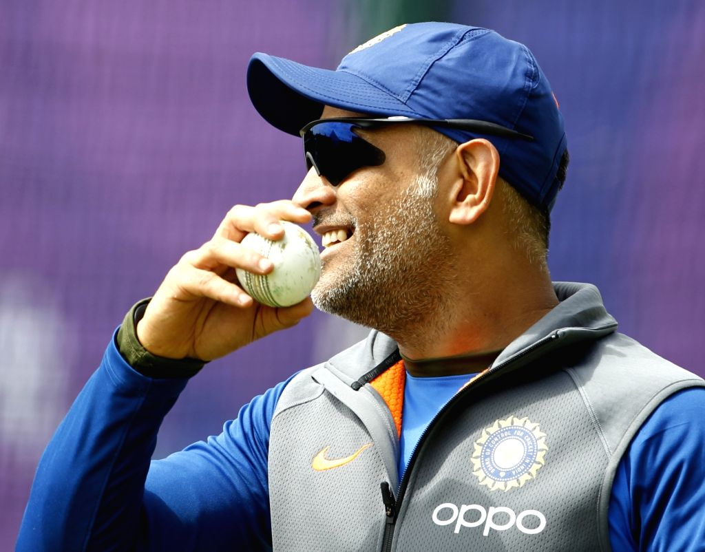 Manchester: India's MS Dhoni during a practice session on the eve of their World Cup 2019 match against West Indies at Old Trafford in Manchester, England on June 26, 2019. (Photo: Surjeet Yadav/IANS) - MS Dhoni and Surjeet Yadav