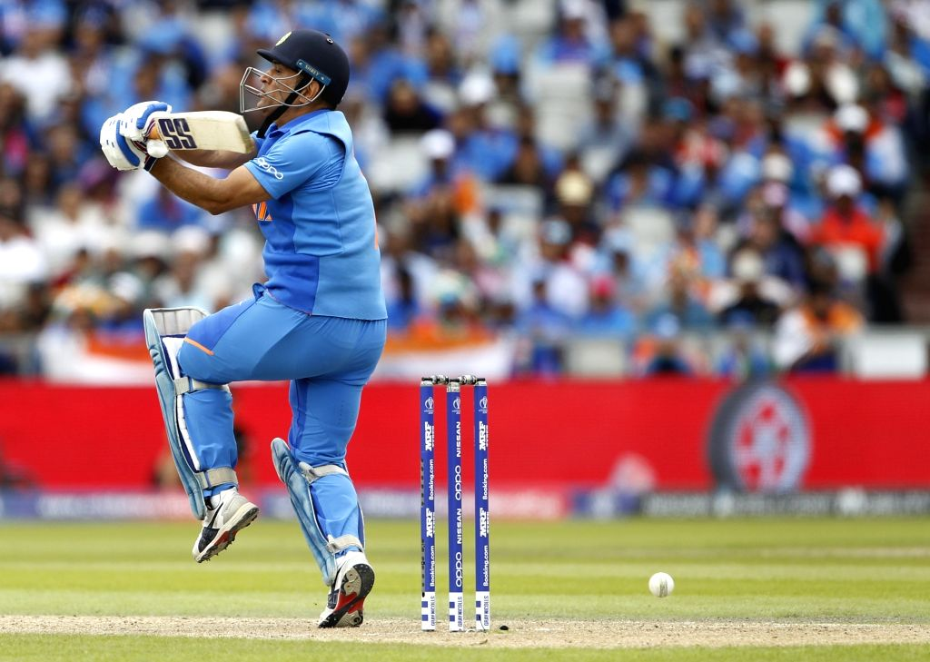 Manchester: India's MS Dhoni in action during the 1st Semi-final match of 2019 World Cup between India and New Zealand at Old Trafford in Manchester, England on July 10, 2019. (Photo: Surjeet Kumar/IANS) - MS Dhoni and Surjeet Kumar