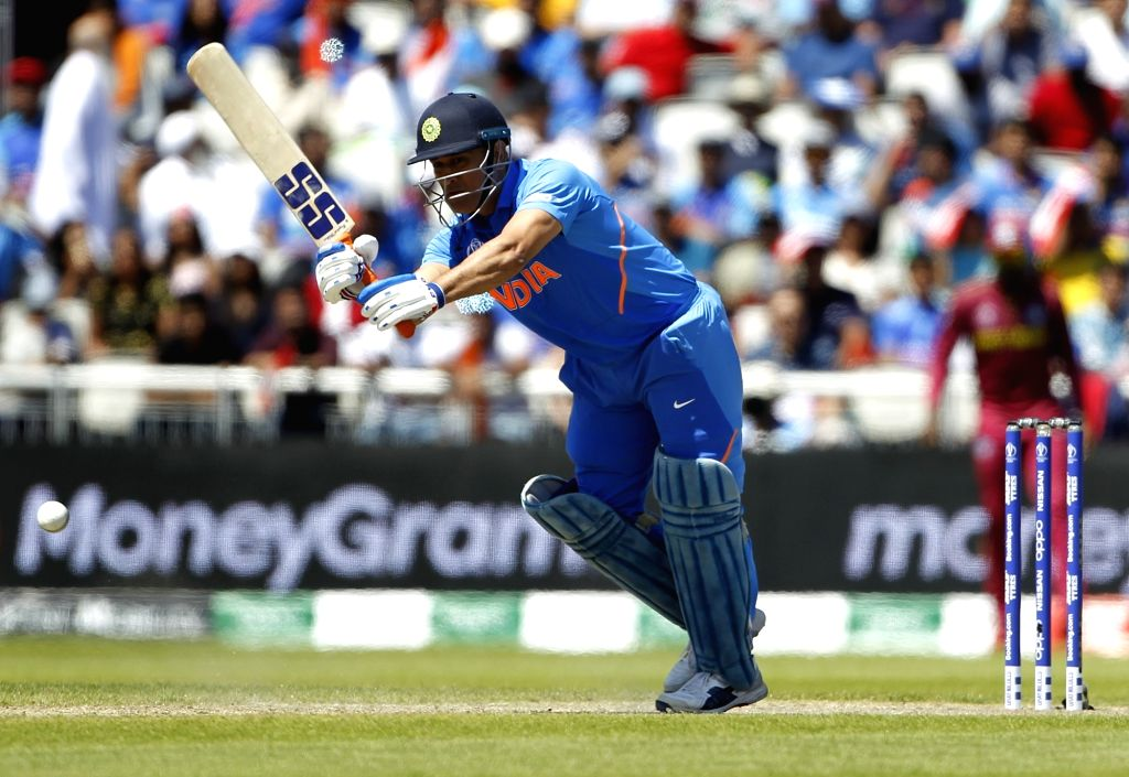 Manchester: India's MS Dhoni in action during World Cup 2019 match between India and West Indies at Old Trafford in Manchester, England on June 27, 2019. (Photo: Surjeet Yadav/IANS) - MS Dhoni and Surjeet Yadav