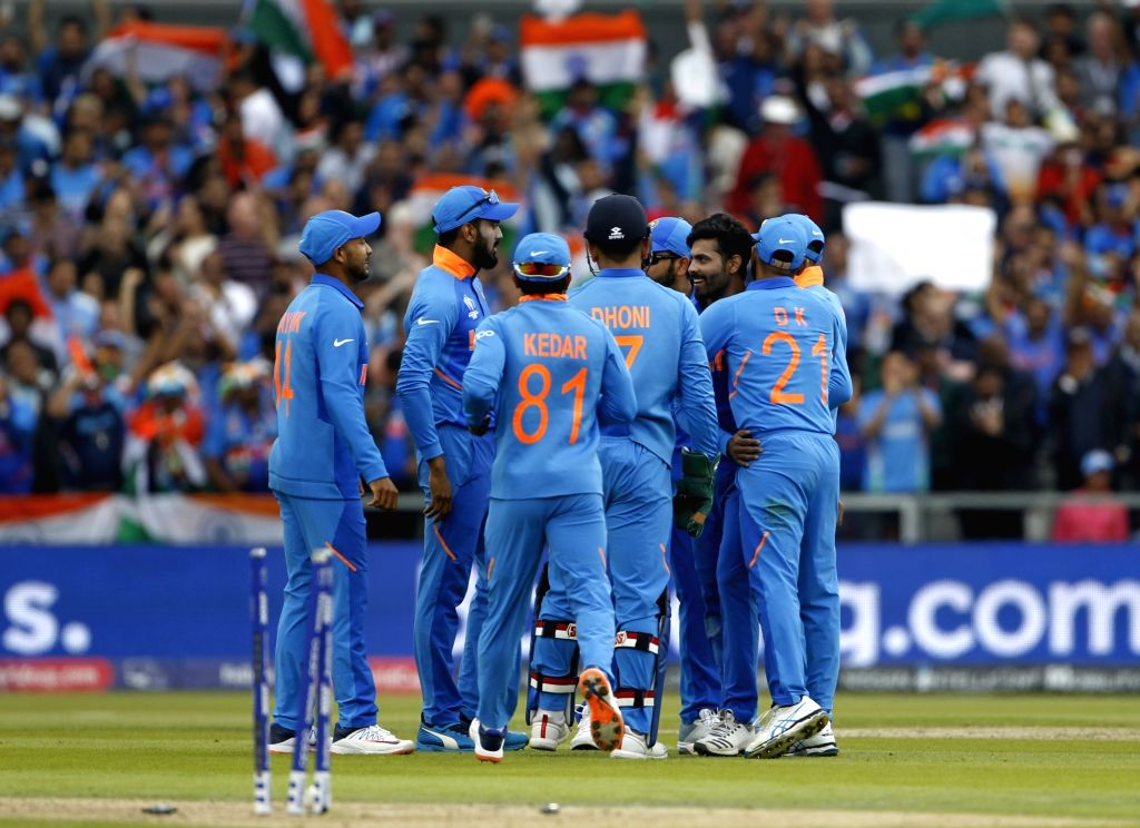 Manchester: India's Ravindra Jadeja celebrates fall of Henry Nicholls' wicket during the 1st Semi-final match of 2019 World Cup between India and New Zealand at Old Trafford in Manchester, England on July 9, 2019. (Photo: Surjeet Kumar/IANS) - Ravindra Jadeja and Surjeet Kumar