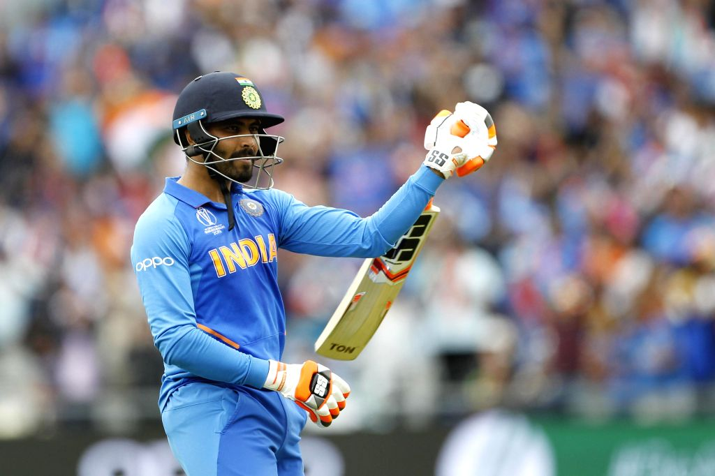 Manchester: India's Ravindra Jadeja celebrates his half century during the 1st Semi-final match of 2019 World Cup between India and New Zealand at Old Trafford in Manchester, England on July 10, 2019. (Photo: Surjeet Kumar/IANS) - Ravindra Jadeja and Surjeet Kumar