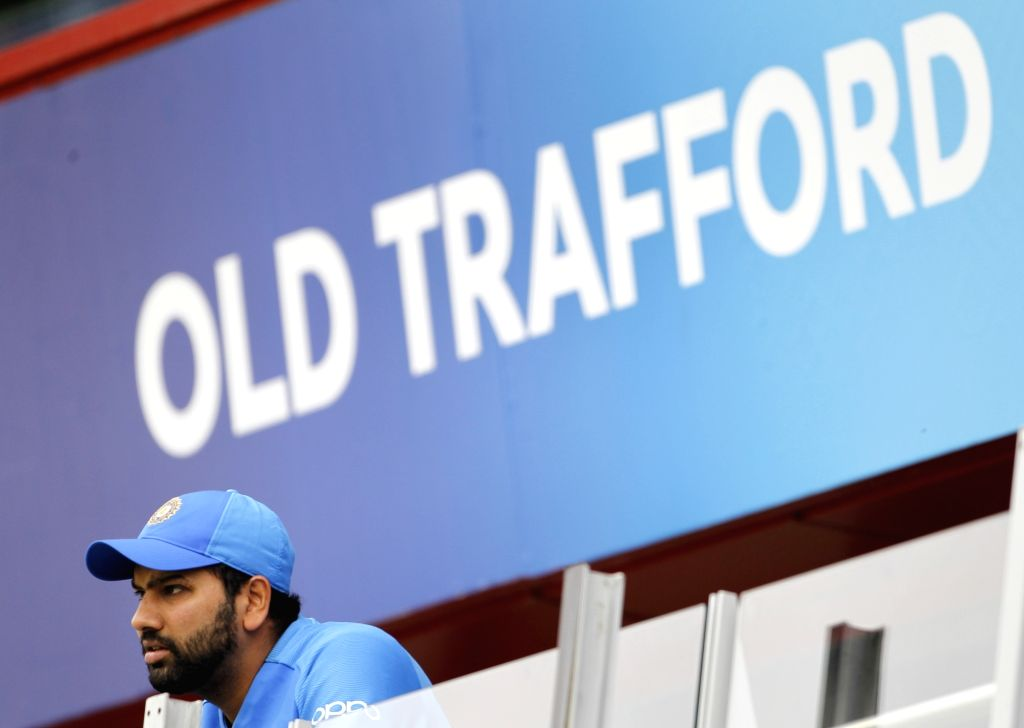 Manchester: India's Rohit Sharma watches the 1st Semi-final match of 2019 World Cup between India and New Zealand at Old Trafford in Manchester, England on July 10, 2019. (Photo: Surjeet Kumar/IANS) - Rohit Sharma and Surjeet Kumar