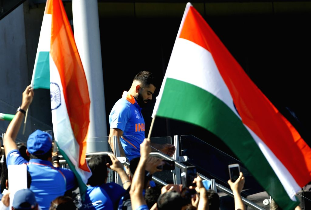 Manchester: India's Virat Kohli ahead of World Cup 2019 match against West Indies at Old Trafford in Manchester, England on June 27, 2019. (Photo: Surjeet Yadav/IANS) - Virat Kohli and Surjeet Yadav