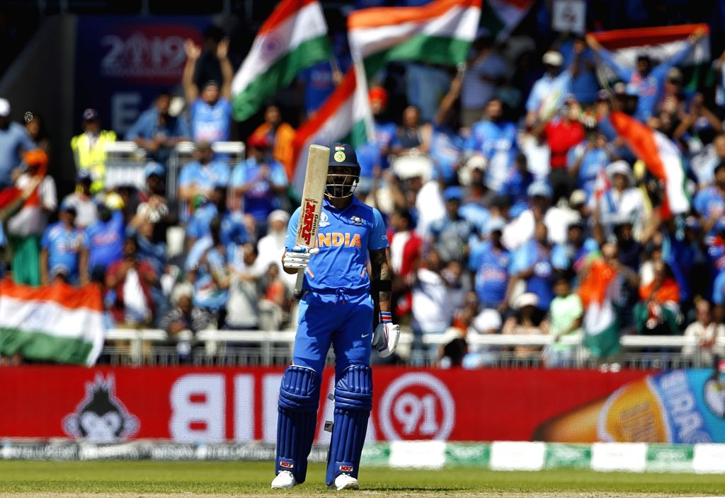 Manchester: India's Virat Kohli celebrates his half century during the World Cup 2019 match between India and West Indies at Old Trafford in Manchester, England on June 27, 2019. (Photo: Surjeet Yadav/IANS) - Virat Kohli and Surjeet Yadav