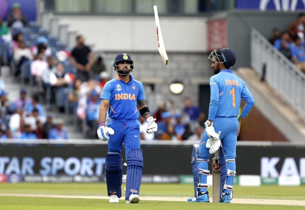 Manchester: India's Virat Kohli reacts after getting dismissed during the 1st Semi-final match of 2019 World Cup between India and New Zealand at Old Trafford in Manchester, England on July 10, 2019. (Photo: Surjeet Kumar/IANS) - Virat Kohli and Surjeet Kumar