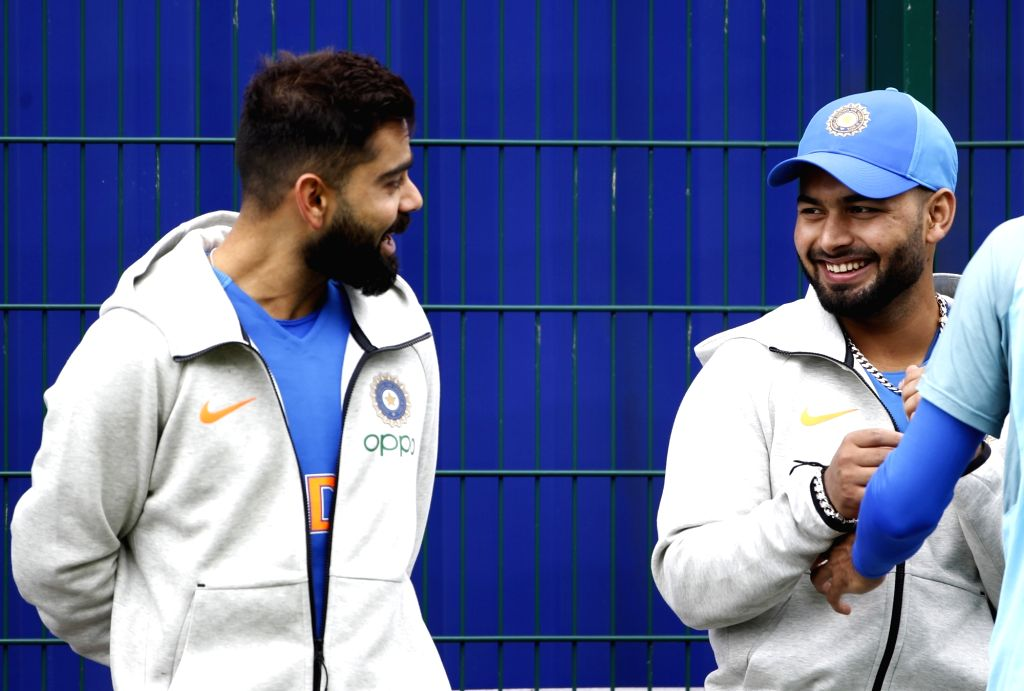 Manchester: Indian cricketers Virat Kohli and Rishabh Pant during a practice session ahead of the World Cup 2019 match against Pakistan in Manchester, England on June 15, 2019. (Photo: Surjeet Yadav/IANS) - Virat Kohli and Surjeet Yadav