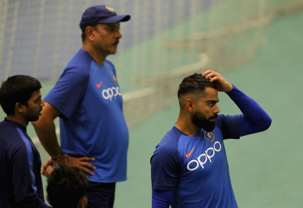 Manchester: Indian Head Coach Ravi Shastri and skipper Virat Kohli during a practice session ahead of the World Cup 2019 match against West Indies at Old Trafford Stadium in Manchester, England on June 25, 2019. (Photo: Surjeet Yadav/IANS) - Virat Kohli and Surjeet Yadav