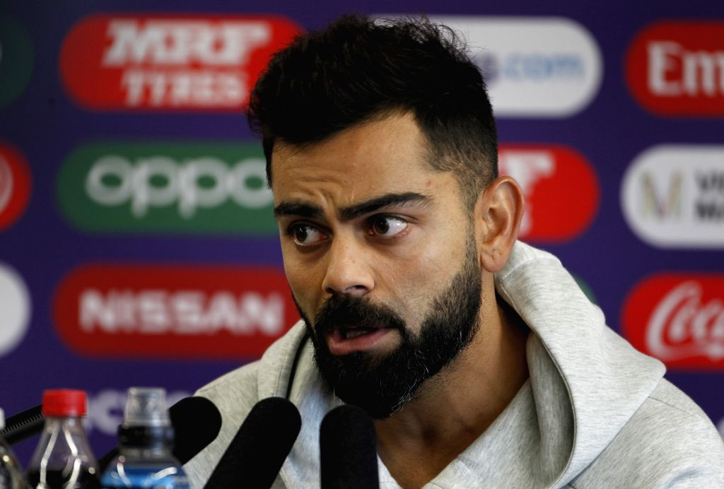 Manchester: Indian skipper Virat Kohli addresses a press conference ahead of the World Cup 2019 match against Pakistan in Manchester, England on June 15, 2019. (Photo: Surjeet Yadav/IANS) - Virat Kohli and Surjeet Yadav