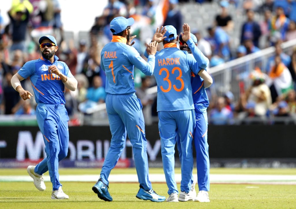 Manchester: Indian skipper Virat Kohli and Ravindra Jadeja celebrates fall of Ross Taylor's wicket during the 1st Semi-final match of 2019 World Cup between India and New Zealand at Old Trafford in Manchester, England on July 10, 2019. (Photo: Surjee - Virat Kohli, Ravindra Jadeja and Surjeet Kumar