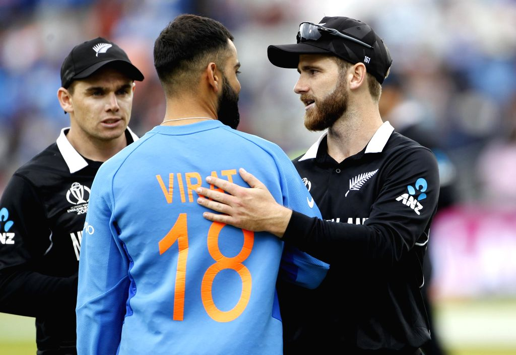 Manchester�: Indian skipper Virat Kohli congratulates New Zealand captain Kane Williamson after New Zealand won the 1st Semi-final match of 2019 World Cup against India at Old Trafford in Manchester, England on July 10, 2019. (Photo: Surjeet Kum - Kane Williamson, Virat Kohli and Surjeet Kumar