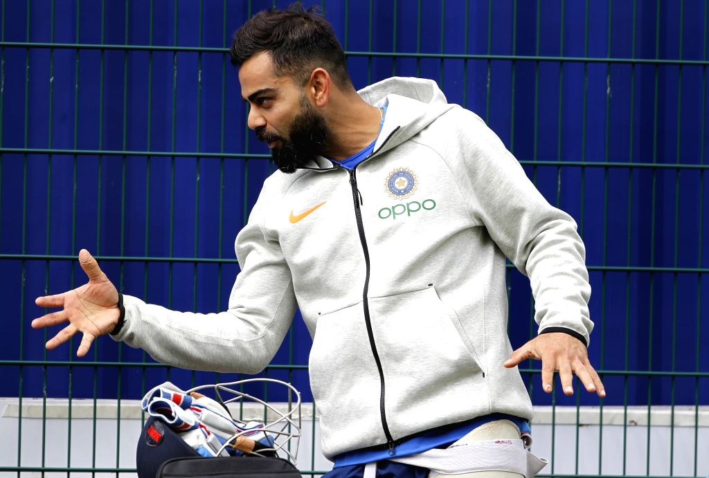 Manchester: Indian skipper Virat Kohli during a practice session ahead of the World Cup 2019 match against Pakistan in Manchester, England on June 15, 2019. (Photo: Surjeet Yadav/IANS) - Virat Kohli and Surjeet Yadav