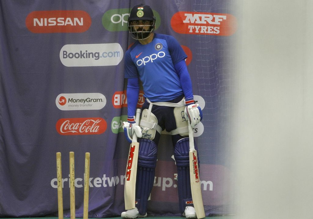 Manchester: Indian skipper Virat Kohli during a practice session ahead of the World Cup 2019 match against West Indies at Old Trafford Stadium in Manchester, England on June 25, 2019. (Photo: Surjeet Yadav/IANS) - Virat Kohli and Surjeet Yadav