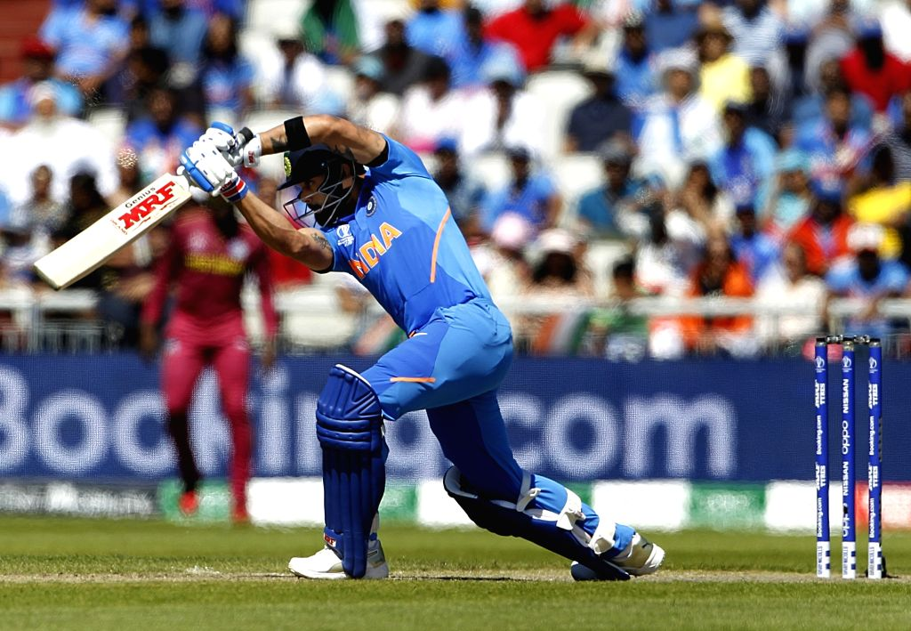 Manchester: Indian skipper Virat Kohli in action during the World Cup 2019 match between India and West Indies at Old Trafford in Manchester, England on June 27, 2019. (Photo: Surjeet Yadav/IANS) - Virat Kohli and Surjeet Yadav