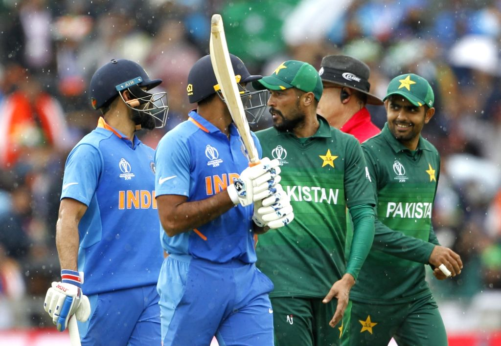 Manchester: Indian skipper Virat Kohli, Vijay Shankar and Pakistan's Mohammad Amir walk back to the pavilion after rains stop the play during the 22nd match of 2019 World Cup between India and Pakistan at Old Trafford in Manchester, England on June 1 - Virat Kohli and Surjeet Yadav