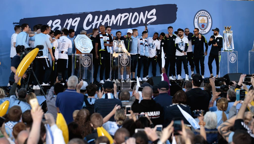 MANCHESTER, May 21, 2019 - Manchester City members and supporters celebrate in Manchester city centre after their team won the domestic treble of champions in Manchester, Britain on May 20, 2019.