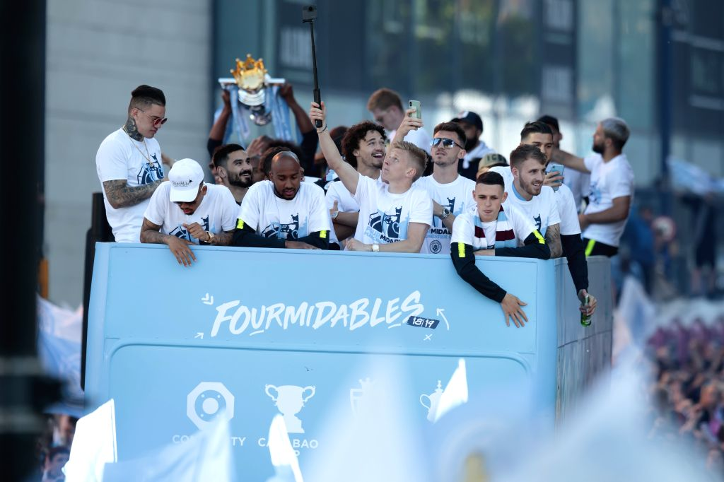 MANCHESTER, May 21, 2019 - Manchester City's players and supporters celebrate in Manchester city centre after their team won the domestic treble of championship in Manchester, Britain on May 20, 2019.