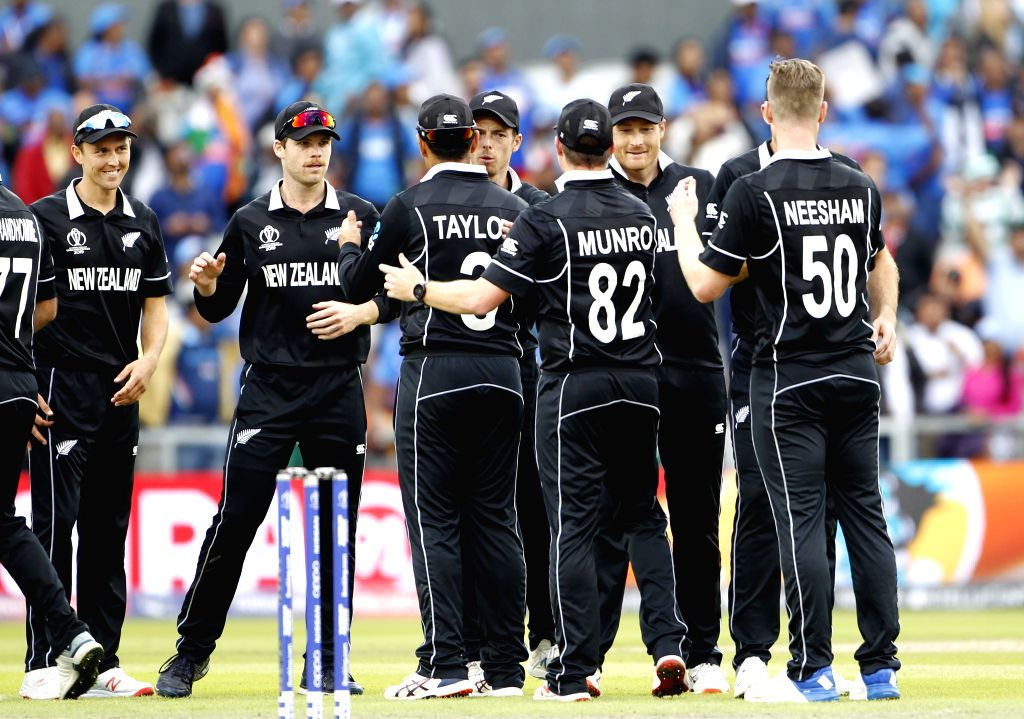 Manchester: New Zealand players celebrate after winning the 1st Semi-final match of 2019 World Cup against India at Old Trafford in Manchester, England on July 10, 2019. (Photo: Surjeet Kumar/IANS) - Surjeet Kumar