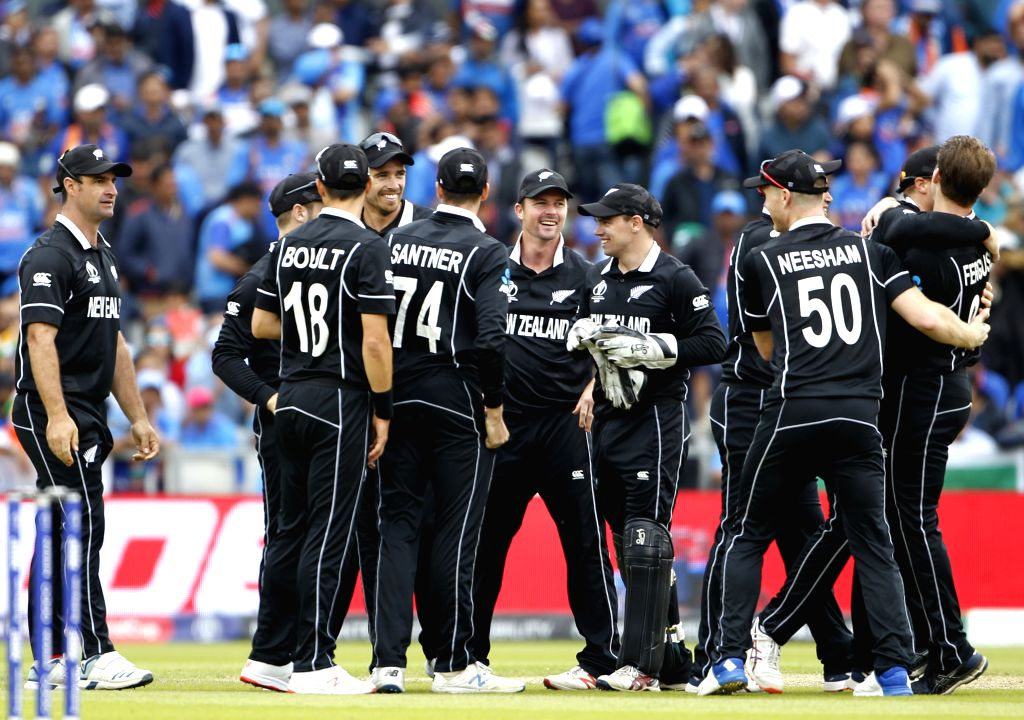 Manchester: New Zealand's Martin Guptill celebrates the dismissal of M.S. Dhoni with teammates during the 1st Semi-final match of 2019 World Cup between India and New Zealand at Old Trafford in Manchester, England on July 10, 2019. (Photo: Surjeet Ku - Surjeet Kumar