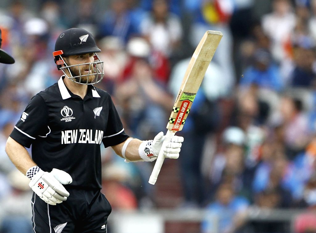 Manchester: New Zealand's skipper Kane Williamson celebrates his half century during the 1st Semi-final match of 2019 World Cup between India and New Zealand at Old Trafford in Manchester, England on July 9, 2019. (Photo: Surjeet Kumar/IANS) - Surjeet Kumar