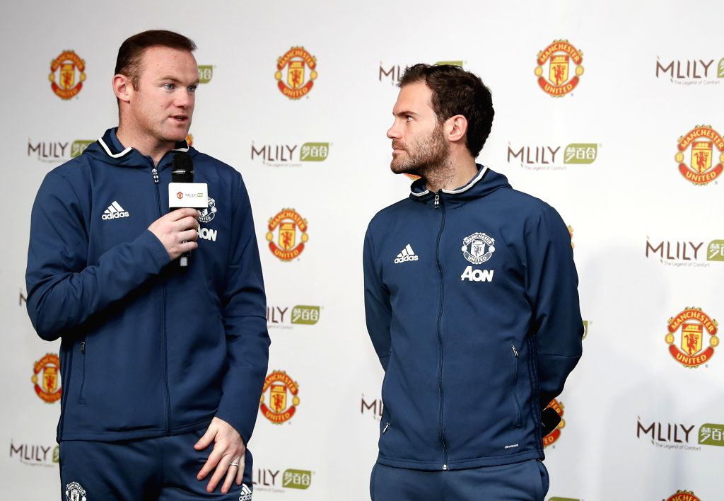 MANCHESTER, Nov. 1, 2016 - Manchester United players Wayne Rooney (L) and Juan Mata attend the press conference during which Manchester United announced a global partnership with Mlily to herald the ...