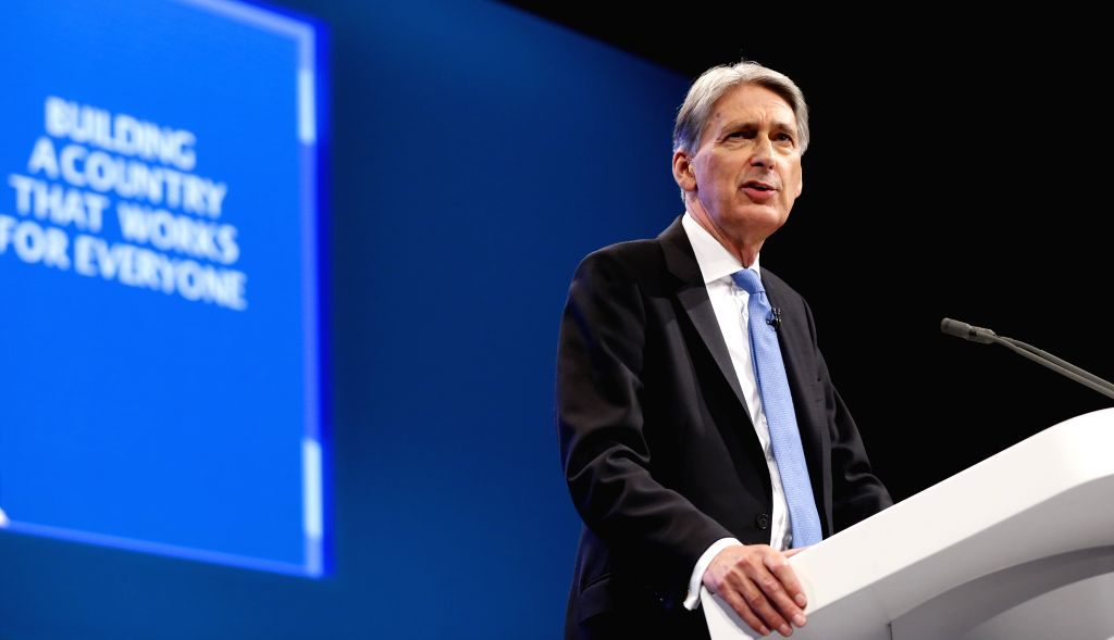 MANCHESTER, Oct. 2, 2017 - British Chancellor of the Exchequer Philip Hammond addresses his keynote speech at the Conservative Party Annual Conference 2017 in Manchester, Britain on Oct. 2, 2017.