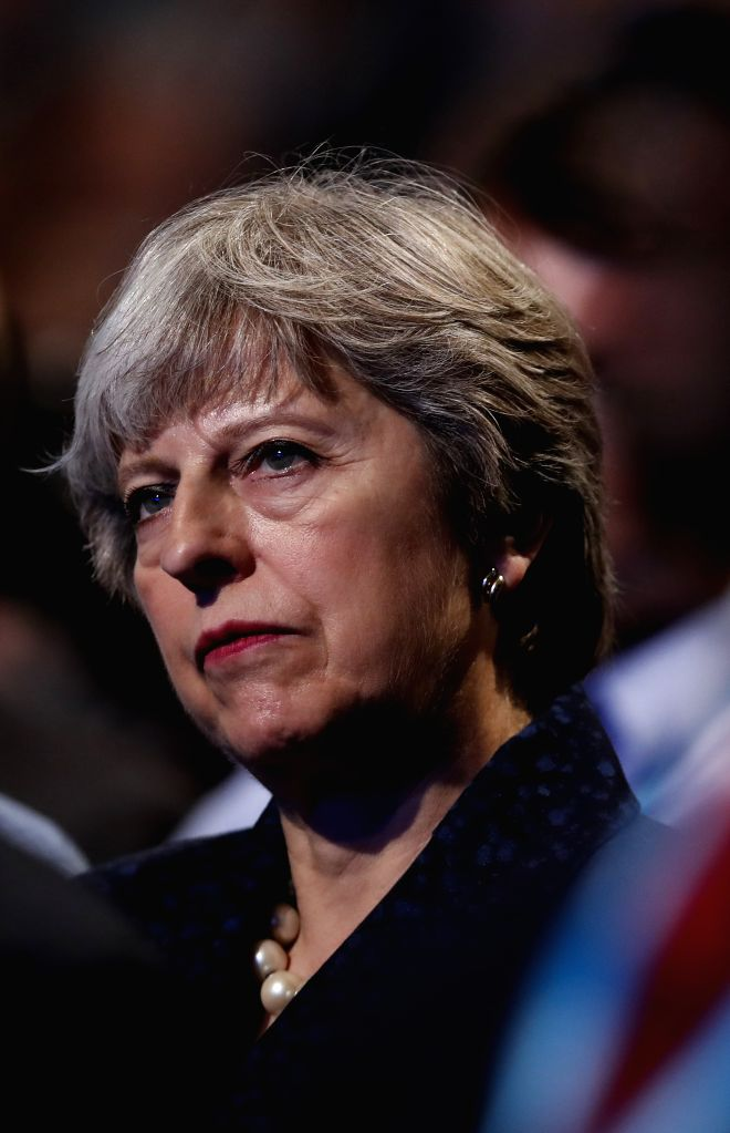 MANCHESTER, Oct. 2, 2017 - British Prime Minister Theresa May listens as Chancellor of the Exchequer Philip Hammond addresses his keynote speech at the Conservative Party Annual Conference 2017 in ... - Theresa May