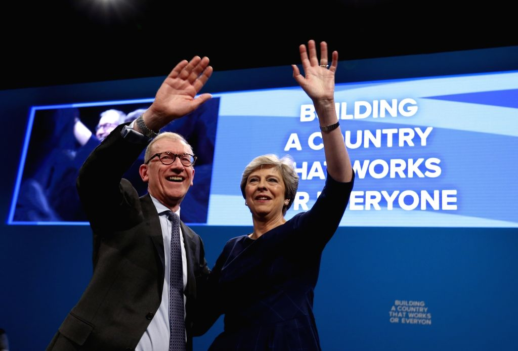 MANCHESTER, Oct. 4, 2017 - Britain's Prime Minister Theresa May waves to the attendees with her husband Philip after delivering her keynote speech on the last day of the Conservative Party Annual ... - Theresa May