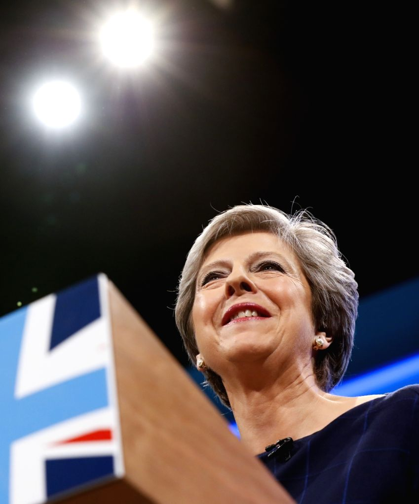 MANCHESTER, Oct. 4, 2017 - Britain's Prime Minister Theresa May walks to the stage to deliver her keynote speech on the last day of the Conservative Party Annual Conference in Manchester, Britain on ... - Theresa May