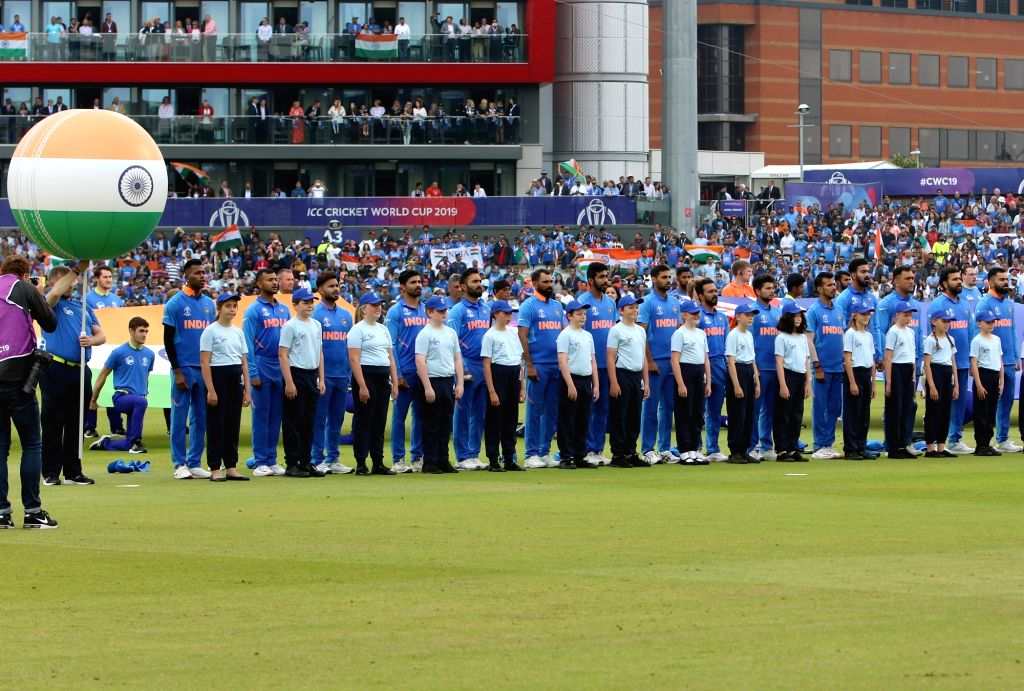 Manchester: Team India stands for the national anthem ahead of the 1st Semi-final match of 2019 World Cup between India and New Zealand at Old Trafford in Manchester, England on July 9, 2019. (Photo: Surjeet Kumar/IANS) - Surjeet Kumar