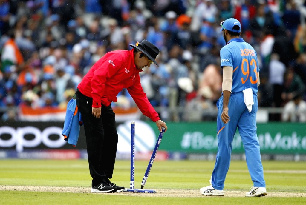Manchester: Umpire Richard Illingworth removing wickets after rains interrupt the 1st Semi-final match of 2019 World Cup between India and New Zealand at Old Trafford in Manchester, England on July 9, 2019. (Photo: Surjeet Kumar/IANS) - Surjeet Kumar