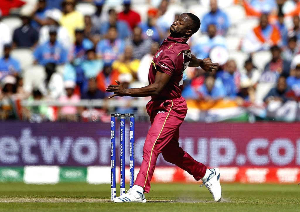 Manchester: West Indies' Kemar Roach in action during World Cup 2019 match between India and West Indies at Old Trafford in Manchester, England on June 27, 2019. (Photo: Surjeet Yadav/IANS) - Surjeet Yadav