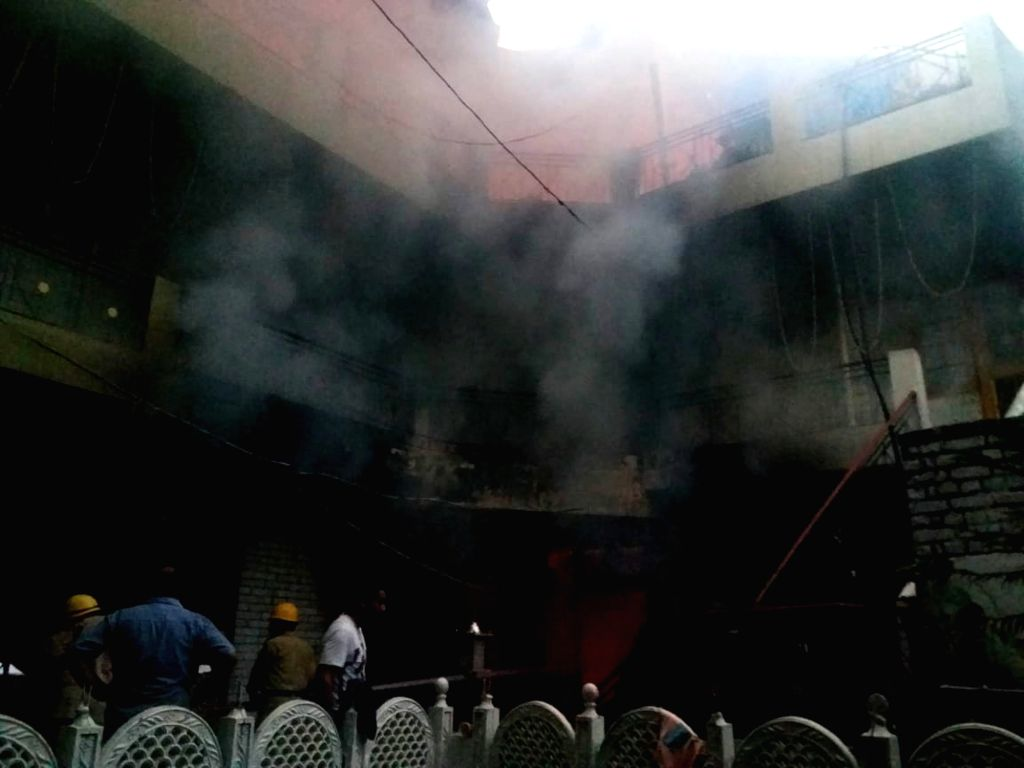 : Mandi: Smoke comes out from the Ner Chowk house that caught fire, in Himachal Pradesh's Mandi on July 23, 2018. At least five persons, including three women, of a wedding party were charred ...