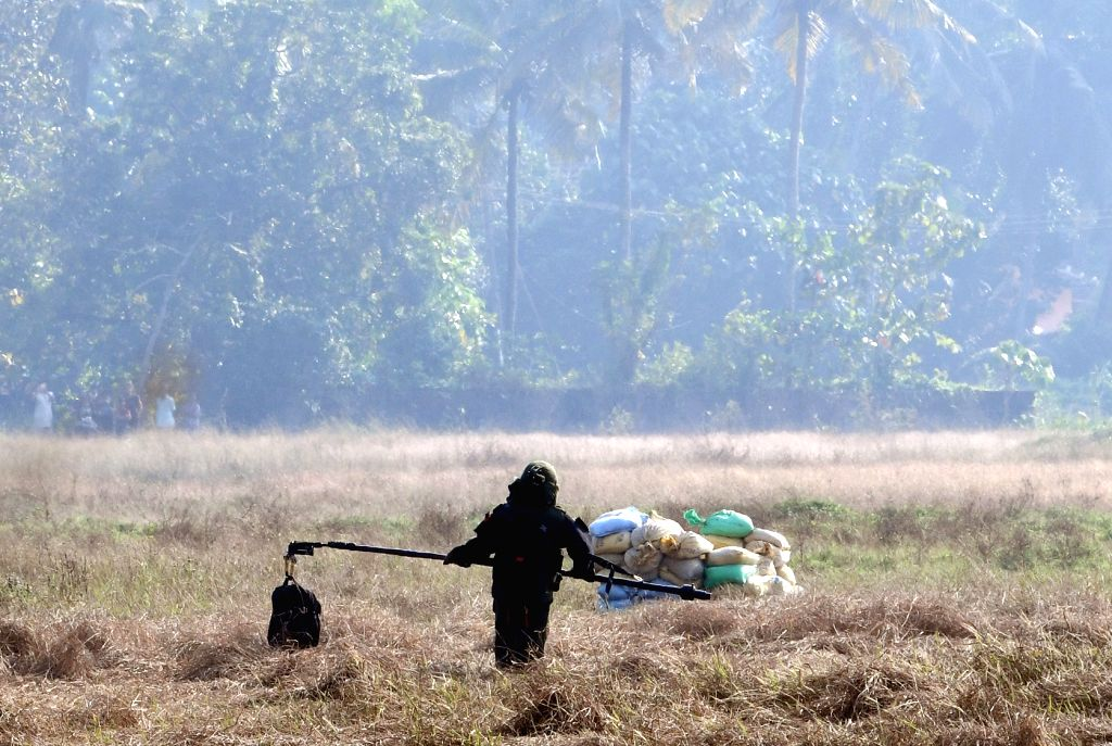 Mangaluru: A member of the Bomb Detection and Disposal Squad (BDDS) takes the low intensity Improvised Explosive Device (IED) that was found inside an unattended bag at the Mangalore airport, for diffusion in Mangaluru on Jan 20, 2020. It all began a