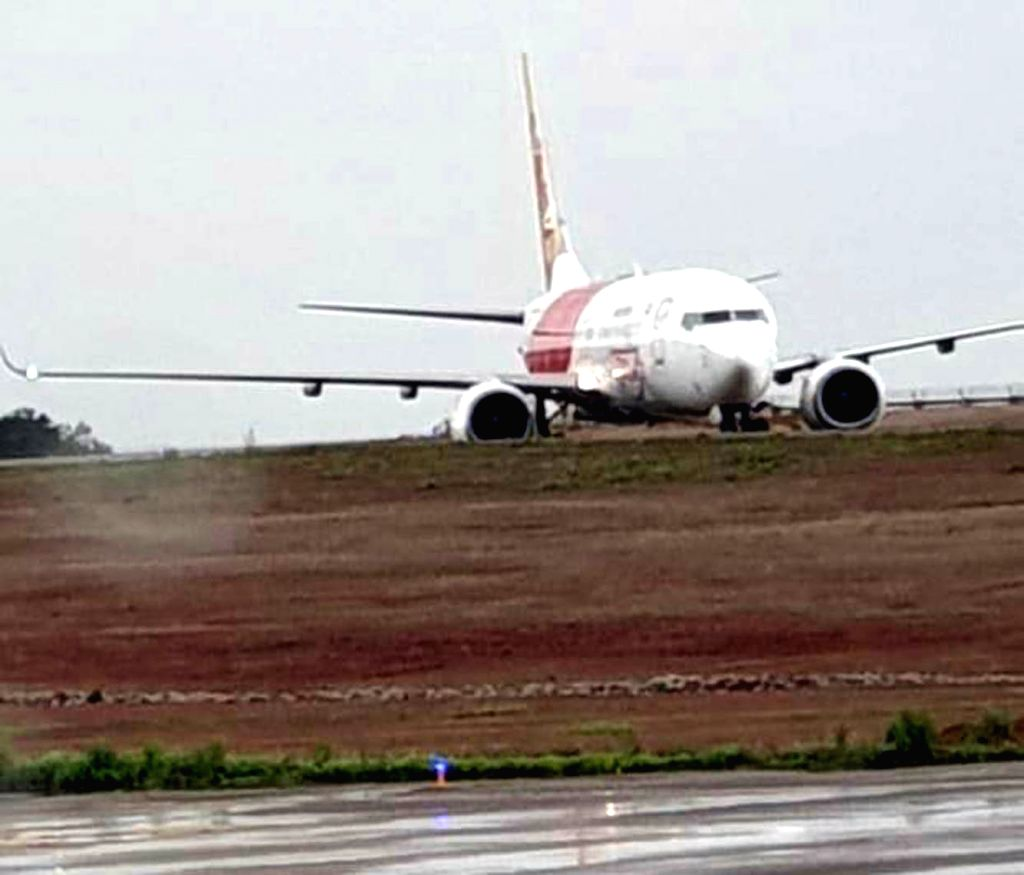 Mangaluru: An Air India Express aircraft VT-AYA, operating IX 384, Dubai to Mangalore veered off the taxiway after landing and got stuck into soft ground at the Mangaluru airport, on June 30, 2019. 183 passengers and crew members on board the Dubai-M