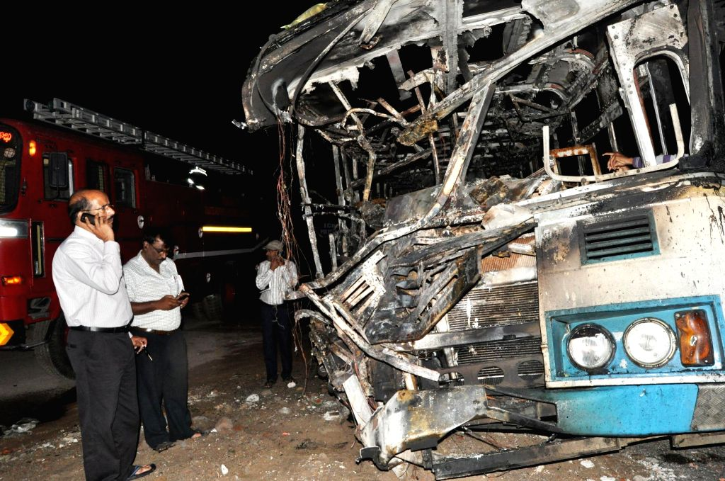 Mangled remains of a bus that collided head-on with a truck at Bowenpally, Hyderabad on Sept 9, 2014. The bus caught fire after the impact, in which three persons are reported to be charred to death .