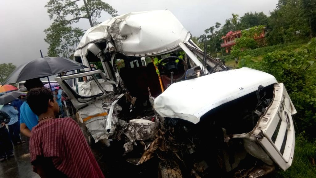 Mangled remains of the bus that collided head on with a passenger vehicle at Thaora Dol in Demow in Upper Assam's Sivasagar district on Sep 23, 2019. At least ten people died and eight others ...