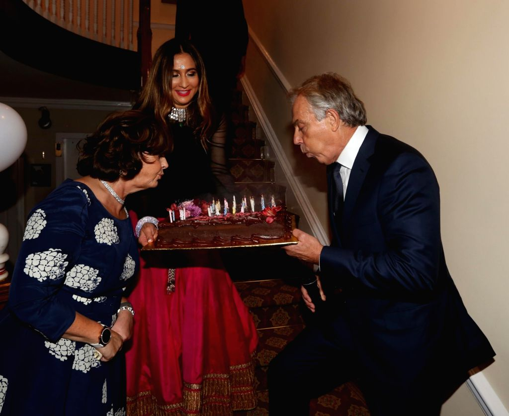 Manhattan (New York): Former British Prime Minister Tony Blair, his wife Cherie Blair and Giving Back Foundation Founder and CEO Meera Gandhi during a celebration in Manhattan, New York on Sept 17, ... - Tony Blair and Meera Gandhi