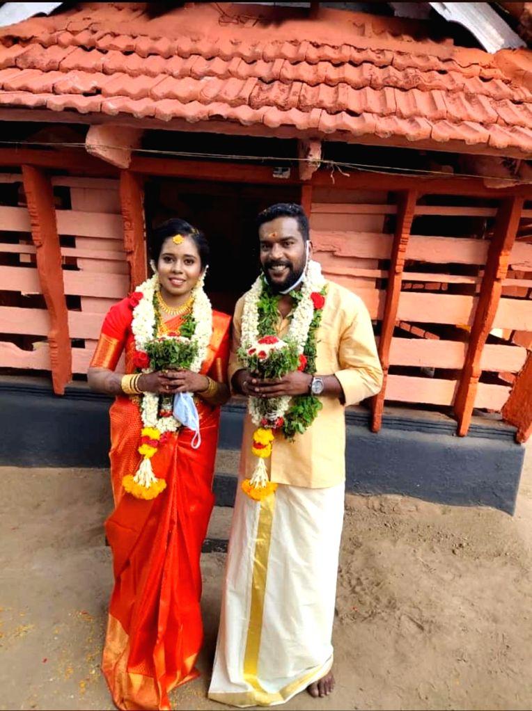 Manikandan Achari with his wife Anjali.