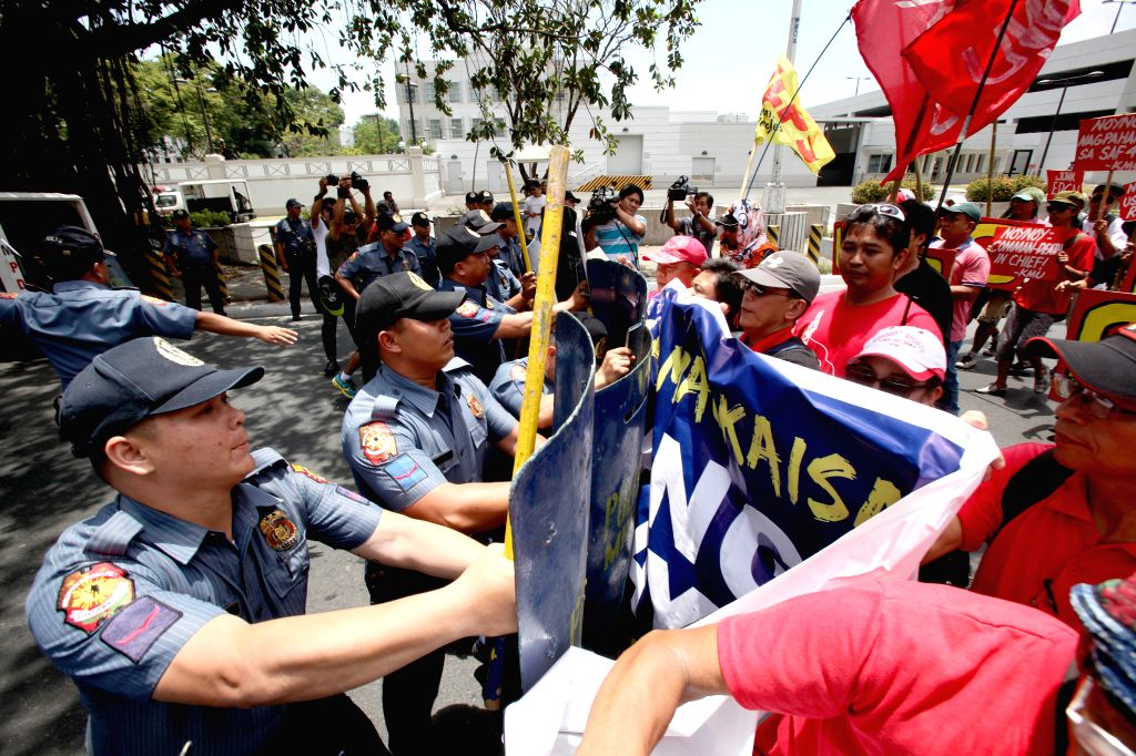 Activists clash with anti-riot policemen during a protest rally against the 2015 RP-US Balikatan Exercises near the U.S. Embassy in Manila, the Philippines, on ...